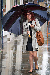 © Licensed to London News Pictures . 10/08/2014 . Manchester , UK . Jennifer Williams with the world's largest umbrella . Rainy day in Manchester today (10th August 2014) . Photo credit : Joel Goodman/LNP