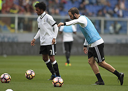 March 19, 2017 - Genoa, Italy - Gonzalo Higuain and Juan Cuadrado during warm up Serie A match between Sampdoria v Juventus, in Genova, on March 19, 2017  (Credit Image: © Loris Roselli/NurPhoto via ZUMA Press)