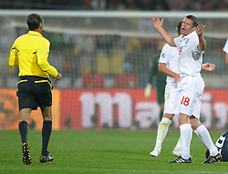 12.06.2010, Sandton - Nelson Mandela Square, Johannesburg, RSA, FIFA WM 2010, 3D television, im Bild Jamie Carragher of England reacts toward Referee, Carlos Simon after getting a Yellow Card, EXPA Pictures © 2010, PhotoCredit: EXPA/ IPS/ Mark Atkins / SPORTIDA PHOTO AGENCY