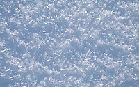 Close-up of glistening snow gives a wonderful, glittering, natural texture.