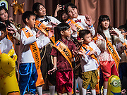09 JANUARY 2016 - BANGKOK, THAILAND: Children perform a Thai pop song during Children's Day festivities at Government House. National Children's Day falls on the second Saturday of the year. Thai government agencies sponsor child friendly events and the military usually opens army bases to children, who come to play on tanks and artillery pieces. This year Thai Prime Minister General Prayuth Chan-ocha, hosted several events at Government House, the Prime Minister's office.       PHOTO BY JACK KURTZ
