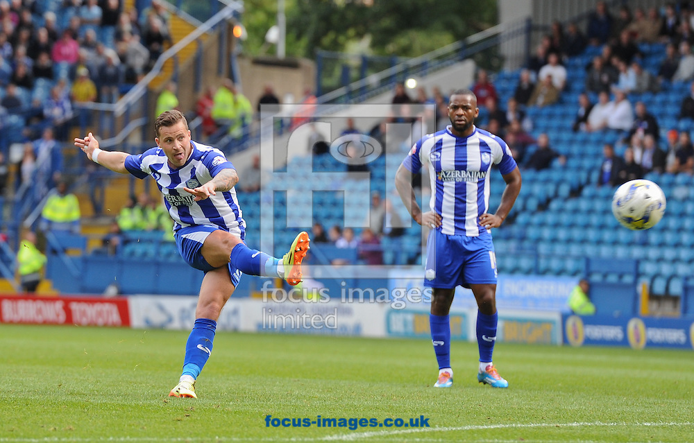 Chris Maguire of Sheffield Wednesday free kick comes back off the cross bar during the Sky Bet Championship match at Hillsborough, Sheffield<br /> Picture by Richard Land/Focus Images Ltd +44 7713 507003<br /> 16/08/2014