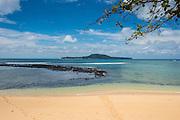 Beach Praia Cabana in the south coast of Sao Tome with Ilheu Roleu in the background, Sao Tome and Principe, Atlantic ocean