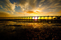 Sunrise on the Beach at the Urangan Pier in Hervey Bay on the coast of Queensland in Australia.<br /> <br /> &copy;2017, Sean Phillips<br /> http://www.RiverwoodPhotography.com