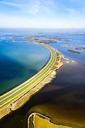 Nederland, Zeeland, Sint Philipsland, 01-04-2016; Philipsdam gezien naar de Krammersluizen met het water van het Krammer. Links van de dam het Laagbekken, rechts Plaat van de Vliet. De Philipsdam is een van de compartimenteringswerken die op hun beurt weer deel uit maken van de Deltawerken.<br /> Philipsdam with Krammersluizen, part of the Delta Works.<br /> <br /> luchtfoto (toeslag op standard tarieven);<br /> aerial photo (additional fee required);<br /> copyright foto/photo Siebe Swart