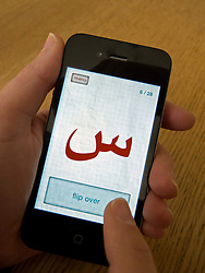 Student learning Arabic using educational app on an Apple iphone 4G smart phone