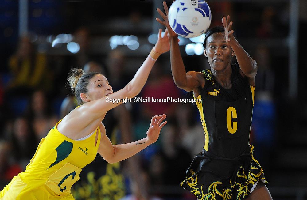 Commonwealth Games, Glasgow 2014<br />  SECC Netball Semi Final<br /> <br /> Australia v Jamaica.<br /> Kimberlee Green of Australia (GOLD) and Paula Thompson of Jamaica<br /> <br />  Neil Hanna Photography<br /> www.neilhannaphotography.co.uk<br /> 07702 246823