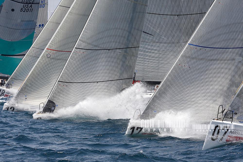 AUDI MED CUP-TP 52 SERIES-MARSEILLE.COPYRIGHT : THIERRY SERAY/DPPI..START Voile, navigation dans le vent fort, mer agitée. Coup de vent, mer démontée, houle, vague, bateaux à la gîte, écume, vague, embruns, clapot, déferlante, départ au loffe, étrave sous l'écume, équipiers au rappel, grain, orage, coup de mistral, dépression, voile déchirée, compétition, maîtrise, esprit d'équipe, performance, départ au surf, glissade, planning