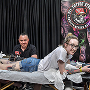Artist 371 Tattoo Studio tattoo a client at The Great British Tattoo Show, London, UK