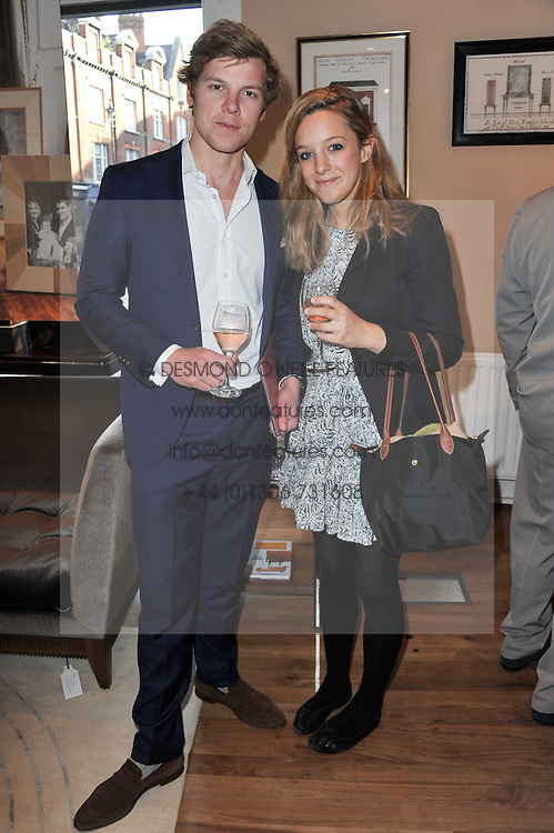 EMMA BURGESS and ADAM DZIUBINSKI at a party to celebrate the publication of 'Garden' by Randle Siddeley held at Linley, 60 Pimlico Road, London on 24th May 2011.
