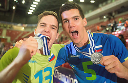 Jani Kovacic #13 of Slovenia and Alen Sket #5 of Slovenia celebrate at trophy ceremony after placed 2nd after volleyball match between National teams of Slovenia and France at Final match of 2015 CEV Volleyball European Championship - Men, on October 18, 2015 in Arena Armeec, Sofia, Bulgaria. Photo by Vid Ponikvar / Sportida