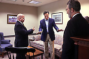 Charles Cornelio (left) and Byron Champlin (right) of Lincoln Financial talk with Presidential contender Mitt Romney during a visit to Lincoln Financial's Concord office; Monday, June 27, 2011. Romney also met with around 200 employees in the office's cafeteria.<br /> <br /> (Alexander Cohn/ Monitor Staff)