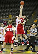 February 16 2011: Iowa Hawkeyes center Morgan Johnson (12) and Wisconsin Badgers forward Lin Zastrow (33) battle for the tipoff during the first half of an NCAA women's college basketball game at Carver-Hawkeye Arena in Iowa City, Iowa on February 16, 2011. Iowa defeated Wisconsin 59-44.