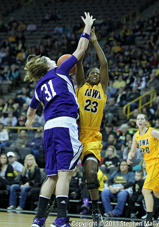 December 30, 2011: Iowa Hawkeyes guard Theairra Taylor (23) is fouled by Northwestern Wildcats forward/center Dannielle Diamant (31) during the NCAA women's basketball game between the Northwestern Wildcats and the Iowa Hawkeyes at Carver-Hawkeye Arena in Iowa City, Iowa on Wednesday, December 30, 2011.