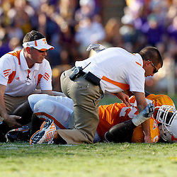 Oct 2, 2010; Baton Rouge, LA, USA; Trainers check on Tennessee Volunteers center Victor Thomas (52) injured on a play during the second half against the LSU Tigers at Tiger Stadium. LSU defeated Tennessee 16-14.  Mandatory Credit: Derick E. Hingle