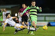 Forest Green Rovers Lee Collins(5) is tackled by Port Vale's James Gibbons(21) during the EFL Sky Bet League 2 match between Forest Green Rovers and Port Vale at the New Lawn, Forest Green, United Kingdom on 6 January 2018. Photo by Shane Healey.