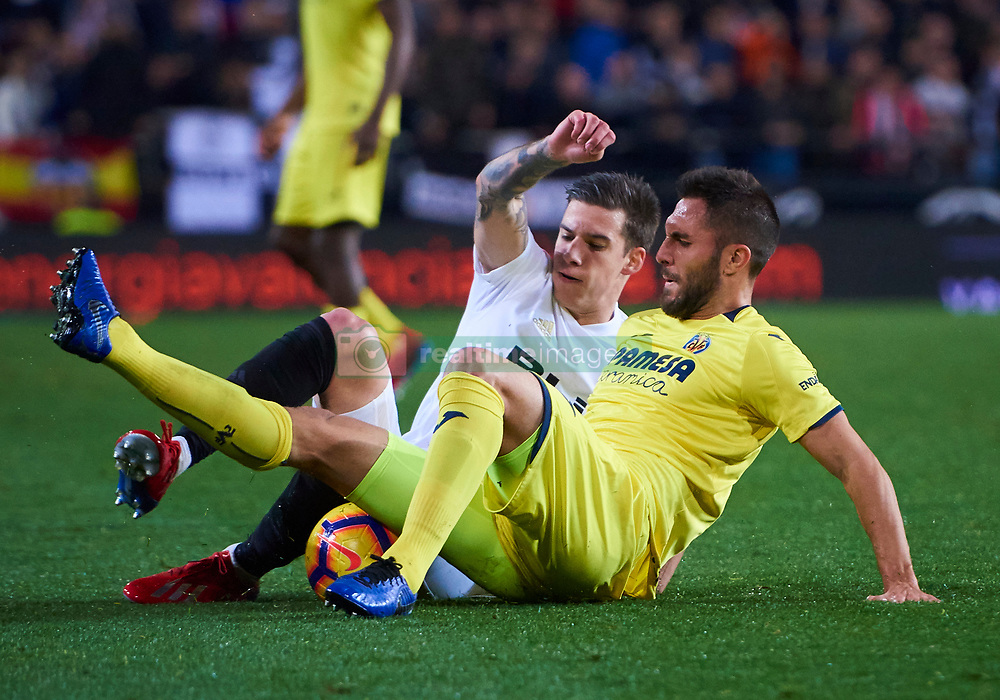 January 26, 2019 - Valencia, U.S. - VALENCIA, SPAIN - January 26: Santi Mina, forward of Valencia CF. He competes for the ball on the ground with Victor Ruiz, central defender of Villarreal CF during the La Liga match between Valencia CF and Villarreal CF at the Mestalla stadium on January 26, 2019 in Valencia, Spain. (Photo by Carlos Sanchez Martinez / Icon Sportswire) (Credit Image: © Carlos Sanchez Martinez/Icon SMI via ZUMA Press)