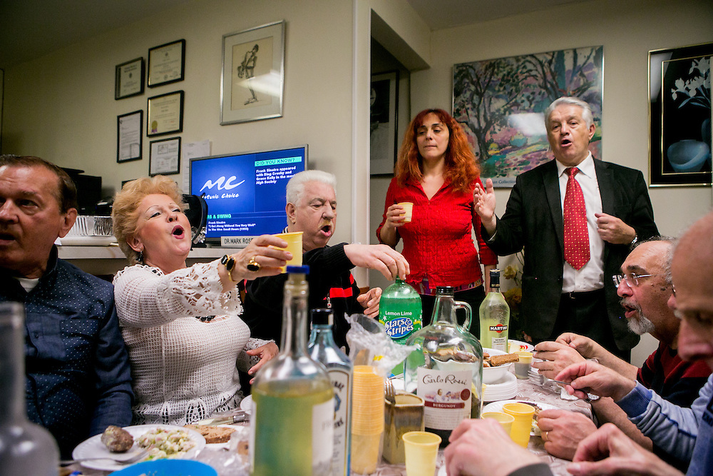 BROOKLYN, NY - MAY 11, 2016: A big-band comprised of many Russians eats dinner and drinks vodka after practicing in the basement of a dentist's office in Sheepshead Bay, New York. CREDIT: Sam Hodgson for The New York Times.