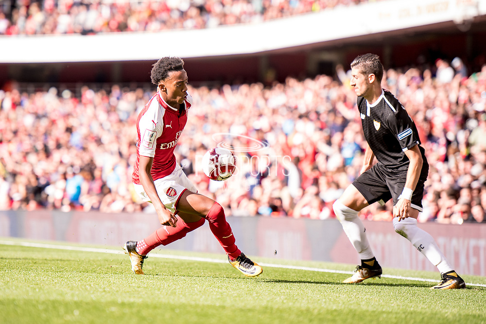 Arsenal Joe Willock (69), Sevilla defender Sergio Escudero (18) during the Emirates Cup 2017 match between Arsenal and Sevilla at the Emirates Stadium, London, England on 30 July 2017. Photo by Sebastian Frej. during the Emirates Cup 2017 match between Arsenal and Sevilla at the Emirates Stadium, London, England on 30 July 2017. Photo by Sebastian Frej.