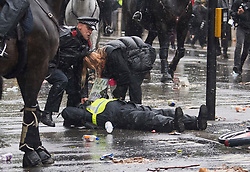 © Licensed to London News Pictures. 06/06/2020. London, UK. A mounted police officer is treated a police college and a protester after falling off her horse during a Black Lives Matter demonstration in Westminster, London, over the killing of African American George Floyd. The death of George Floyd, who died after being restrained by a police officer In Minneapolis, Minnesota, caused widespread rioting and looting across the USA. Photo credit: Ben Cawthra/LNP