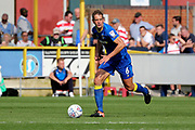 AFC Wimbledon defender Paul Robinson (6) dribbling during the EFL Sky Bet League 1 match between AFC Wimbledon and Doncaster Rovers at the Cherry Red Records Stadium, Kingston, England on 26 August 2017. Photo by Matthew Redman.