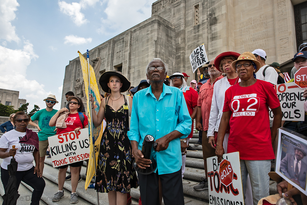 """Marchers on the steps of the State Capitol in Baton Rouge on the last  day of a five day march through Louisiana's 'Cancer Alley' held by the Coalition Against Death Alley. The Coalition Against Death Alley (CADA), is a group of Louisiana-based residents and members of various local and state organizations, is calling for a stop to the construction of new petrochemical plants and the passing of stricter regulations on existing industry in the area that include the groups RISE St. James, Justice and Beyond, the Louisiana Bucket Brigade, 350 New Orleans, and the Concerned Citizens of St. John  Louisiana's Cancer Alley, an 80-mile stretch along the Mississippi River, is also known as the """"Petrochemical Corridor,"""" where there are over 100 petrochemical plants and refineries"""