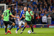 AFC Wimbledon defender Terell Thomas (6) held by Ipswich Town forward James Norwood (10) during the EFL Sky Bet League 1 match between Ipswich Town and AFC Wimbledon at Portman Road, Ipswich, England on 20 August 2019.