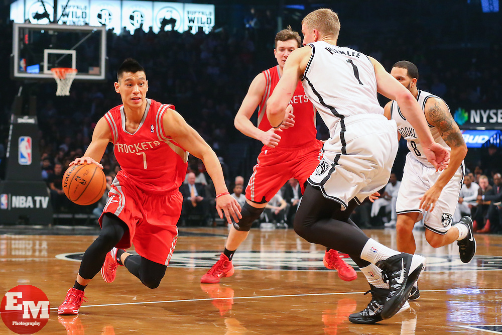 Apr 1, 2014; Brooklyn, NY, USA; Houston Rockets guard Jeremy Lin (7) dribbles the ball while being defended by Brooklyn Nets forward Mason Plumlee (1) during the first quarter at Barclays Center.