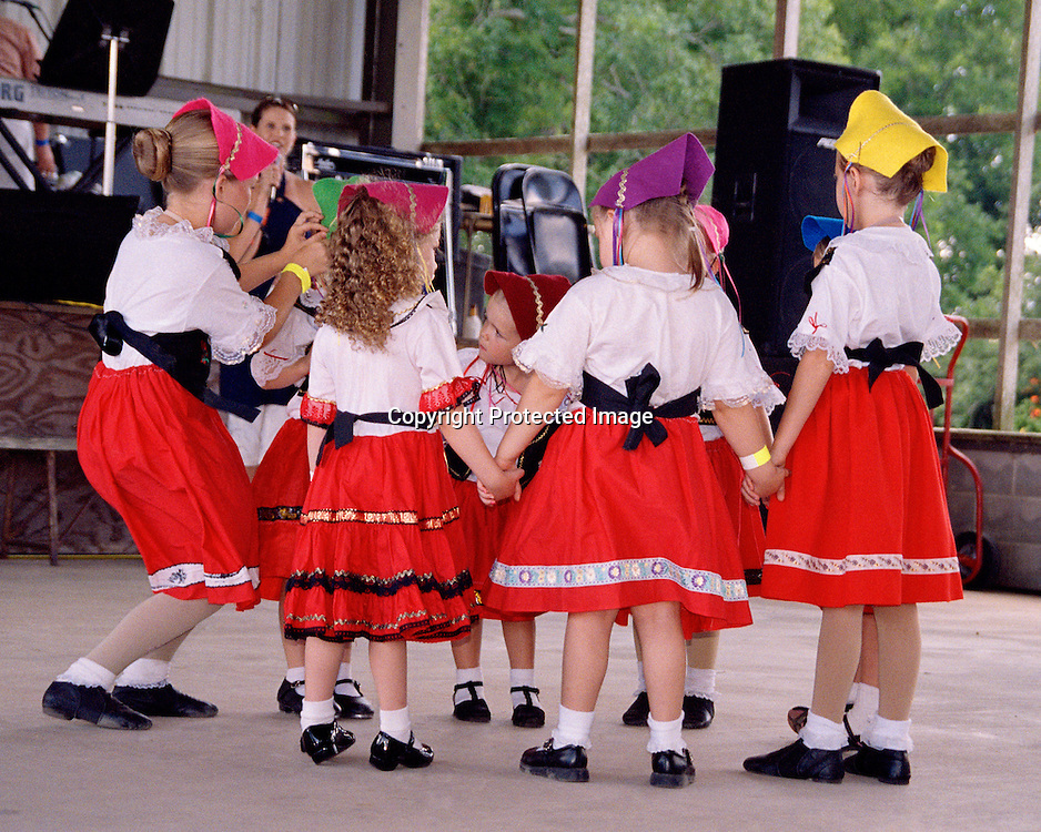 """Girls prepare to dance at the Kolache-Klobase Festival celebrating Czech heritage in East Bernard, Texas. NOTE: Click """"Shopping Cart"""" icon for available sizes and prices. If a """"Purchase this image"""" screen opens, click arrow on it. Doing so does not constitute making a purchase. To purchase, additional steps are required."""