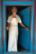 Man in doorway of his home in Nagapattinam.<br />
