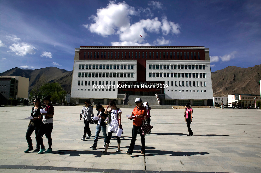 """LHASA, JUNE-16, 2009 : students wak in front of the Tibetan university that is also nicknamed """" little Potala """" due to it's design."""