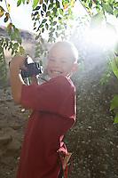 Boy (7-9) using binoculars