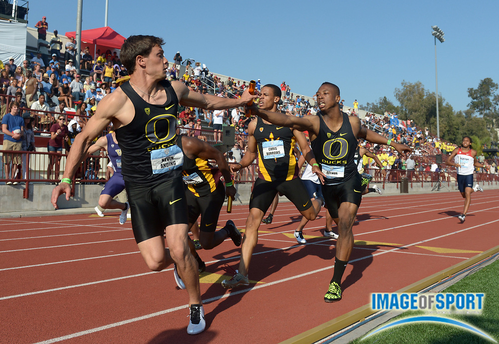 May 12, 2013; Los Angeles, CA, USA; Kevin Anding takes the handoff from Arthur Delaney on the third leg of the Oregon 4 x 400m relay that won in 3:05.63 in the 2013 Pac-12 Championships at Cromwell Field.