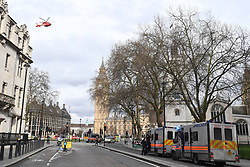 An Air Ambulance takes off close to the Palace of Westminster, London, after policeman has been stabbed and his apparent attacker shot by officers in a major security incident at the Houses of Parliament.