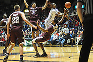 "Mississippi Rebels guard Stefan Moody (42) is fouled by Texas A&M Aggies center Tonny Trocha-Morelos (10) while driving past Texas A&M Aggies guard Alex Robinson (3) and Texas A&M Aggies guard Peyton Allen (22) at the C.M. ""Tad"" Smith Coliseum in Oxford, Miss. on Wednesday, February 4, 2015. (AP Photo/Oxford Eagle, Bruce Newman)"