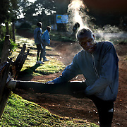 Steam pours off of a runner as he stretches following his morning run. The recent post-election violence in Kenyan disrupted many runners training programs, but they are now back in training for the upcoming Olympic games in China and other international events.