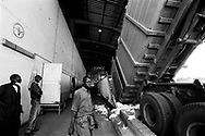 A truck load of cotton is delivered to the Sofitex (recently privatized state cotton company) Bobo III cotton processing factory.<br /> Bobo-Dioulasso, Burkina Faso. 16/12/2003.<br /> Photo &copy; J.B. Russell