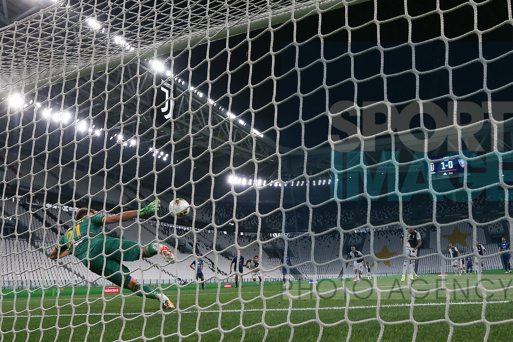 Juventus's Portuguese striker Cristiano Ronaldo scores from the penalty mark to give the side a 2-0 lead during the Serie A match at Allianz Stadium, Turin. Picture date: 26th June 2020. Picture credit should read: Jonathan Moscrop/Sportimage