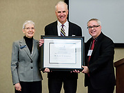 Dr. Randy Kamphaus is honored at the School of Education conference. Photo by Edward Bell.