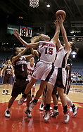 The Flyers Ashley Armstrong (15) and Kendel Ross (2)  go after a rebound as during a UD Women's basketball game at the University of Dayton Arena, January 21, 2007.