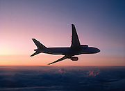 Boeing 777 Airliner in flight at Sunset