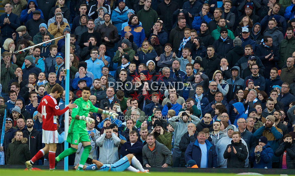 MANCHESTER, ENGLAND - Saturday, November 5, 2016: Manchester City's supporters look dejected after Sergio Aguero misses a chance against Middlesbrough during the FA Premier League match at the City of Manchester Stadium. (Pic by David Rawcliffe/Propaganda)