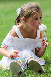 © Licensed to London News Pictures. 25/07/2019. London, UK. Christie aged 5 from Glasgow enjoys an ice cream on a hot and sunny day in St James's Park. According to the Met Office, today will be the hottest day of the year and temperatures are expected to break records. <br /> <br /> **Permission granted**<br /> <br /> Photo credit: Dinendra Haria/LNP