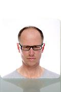 portrait of adult male wearing glasses