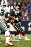 Bills running back Travis Henry (20) carries the ball into heavy traffic while rushing for only 67 yards on 24 carries during a 20 to 3  win by the Miami Dolphins over the Buffalo Bills in an NFL Week 16 game in Buffalo on December 21, 2003. ©Paul Anthony Spinelli