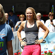 Tournament Director Anne Worcester (left),  takes the ALS Ice Bucket Challenge with the help of Tennis players Simona Halep, (not in frame), Caroline Wozniack, (centre), and Petra Kvitova, (right), during the Connecticut Open at the Connecticut Tennis Center at Yale, New Haven, Connecticut, USA. 17th August 2014. Photo Tim Clayton