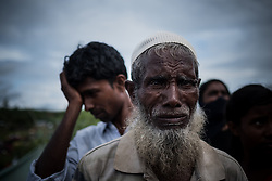 In a refugee camp,Ukhia, Bangladesh. A Rohingya is waiting for food supplies. He sais that his son was burned alive by Burmese soldiers.<br />