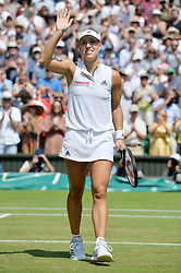 © Licensed to London News Pictures. 12/07/2018. London, UK. Angelique Kerber of Germany plays Jelena Ostapenko of Latvia in the women's semi-finals round singles draw of the Wimbledon Tennis Championships 2018, at the All England Lawn Tennis and Croquet Club. Photo credit: Ray Tang/LNP