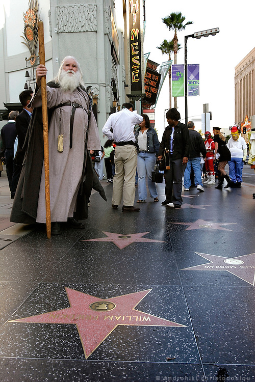 Actor impersonating the wizard Gandalf from the movie Lord Of The Rings, in front of the Chinese Theatre on Hollywood Blv.