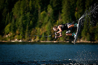 Matt Gencarella gets sideways over the water of Hayden Lake in Idaho during a wakeboarding trip.